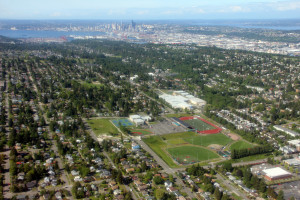 Above West Seattle High School athletic fields with Seattle skyline in background.