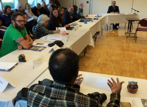 Somali community leader addressing WA Gov Jay Inslee at South Park Community Center in Seattle on WA Climate Tour.