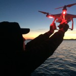 Hand catching a drone off a salmon fishing boat in Seattle's Elliot Bay