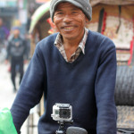GoPro camera mounted on rickshaw handlebars