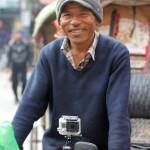 GoPro camera mounted on rickshaw handlebars