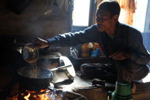 My old friend Anglakba making popcorn and tea one morning in the village