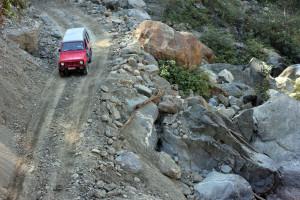 Navigating a high mountain road in the Helambu region