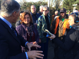 Gov Inslee in South Park at a children's playground next to the adjacent freeway.