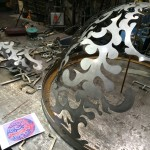 Pieces of a Jon Clarren Metal Sculpture Await Assembly