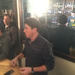 Vitamix rep speaking to bartender awardee as he prepares cocktail