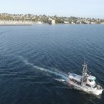 Drone's Eye View of Salmon Fishing Boat Leaving Shilshole Marina in Seattle