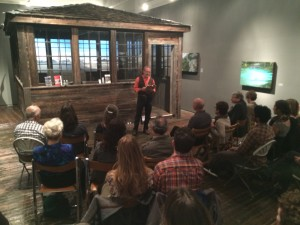 Saul Weisberg, co-founder and Executive Director of North Cascades Institute reading poetry at 'The Lookout - Solace in Mountain Solitude' exhibit of artist Tori Karpenko at The Traver Gallery in Seattle